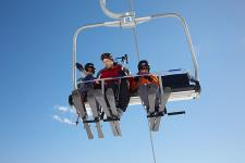 Skiers on ski lift in Tatranska Lomnica