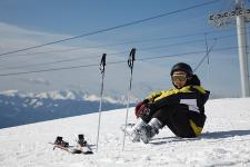 Skier sitting on snow